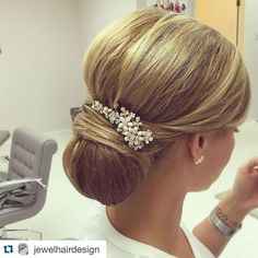 "Our gold ""Gabriela"" bridal hair comb goes perfectly with this sleek chignon bridal updo created by Jewel Hair Design. Elegant, timeless bridal hairstyle."
