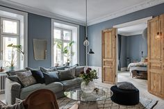 blue on blue living room with raw wood Home Living Room, Living Room Designs, Gravity Home, Scandinavian Apartment, Two Bedroom Apartments, Blog Deco, Blue Walls, Living Room Inspiration, Beautiful Interiors
