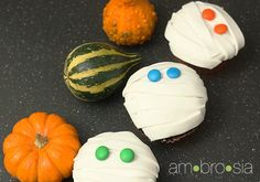 """This Halloween, have kids help """"bandage"""" these mummies in fondant before they devour them."""