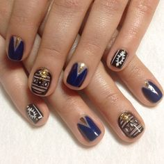 Gorgeous muted Aztec inspired nail art design.