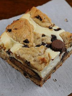 OMGosh!!!! ALL of my favorite things in ONE!! Peanut Butter Chocolate Chip Cookie Dough Cheesecake Bars