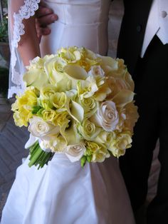 Yellow & White Bridal Bouquet.Flowers of Charlotte loves this!  Find us at www.charlotteweddingflorist.com