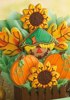 Fabulous Thanksgiving Sugar Cookies featuring scarecrows, pumpkins and sunflowers.