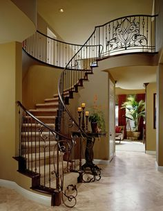 Robesome Designs.  Elegant and stunning Iron staircase #stairs #staircase #design #banister #iron #decor #interior