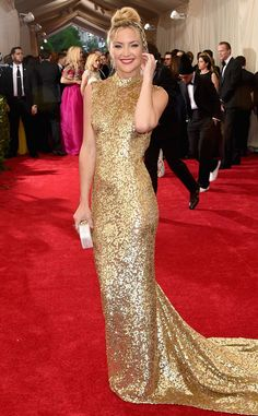 BEST:Kate Hudson in Michael Kors. I love this look . I like the long fitted dress with the turtleneck line and the color and way the dress looks is great.