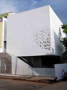 """Traditionally known in India as """"jali walls,"""" apart from adding architectural interest these perforated walls also serve to passively cool and ventilate the house."""