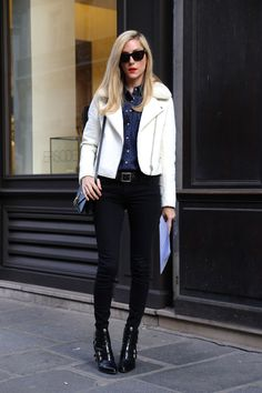 Joanna Hillman sports black and blue denim with a pop of white for a classic yet chic look.