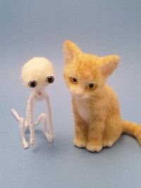 Needle felted cat showing underlying armature and finished cat.