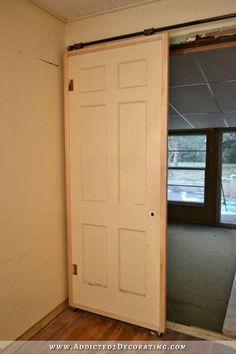 Inexpensive DIY barn door style rolling doors with cheap $60 hardware
