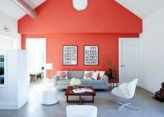 living-room-with-a-bright-coral-accent-wall-and-iconic-furniture - Home Decorating Trends - Homedit Coral Accent Walls, Coral Walls, White Walls, Passive House, Living Room Remodel, Living Room Grey, Room Colors, Wall Colors, Paint Colors