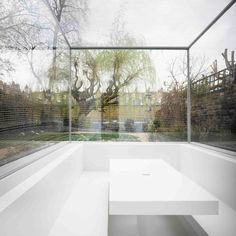 "Gianni Botsford sinks ""invisible"" extension<br /> into the garden of a London house"