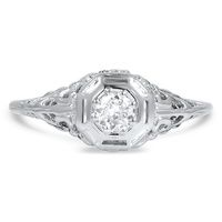 Floral details and a unique octagonal setting make this 10K white gold and round brilliant cut diamond ring a vision of Edwardian style (approx. 0.32 total carat weight).