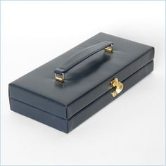 Midnight blue leather box bag with brass window latch.