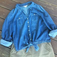 Cute denim style button-up with tie at the waist Cute button-up, denim style shirt, 100% cotton. Size is a junior's large. Worn one time to a concert.  great condition, a wardrobe staple for sure! Pet-free, smoke-free home. Energie Tops Button Down Shirts