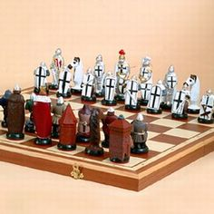 """The Battle of Grunwald (1st Battle of Tannenberg) King Władysław Jagiełło's victory over the Teutonic Order in 1410. Substantial work and research had to be conducted in order to get all Coat-of-Arms, colors of uniforms, and other important battle details correct for each chess piece figure. Each fabric-bottomed piece is made of resin and then hand painted, stylized and polished. The Birchwood board with pine box closes with using brass hinges.  Weight: 11.0 lbs King 5.0"""" dims: 23"""" x 23"""" x…"""