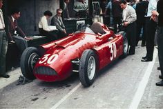 Spa F1 GP, 1955 • Castellotti's Lancia D50 (pole position). No red car could resist the Mercedes-Benz W196 of Fangio and Moss.