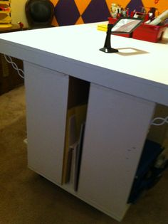 There is a gap between the shelves in the table for storage of foam core and poster board