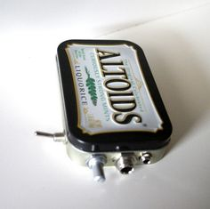 Mint Tin Pocket Guitar Amp, Headphone Amp, MP3 Amp w/ Speaker, Volume Control, & 10X Gain (Black Liquorice Altoids). $35.00, via Etsy.