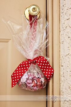 For Valentine's Day or just when someone needs to feel a little extra loved - a door knob hanger bag of Hershey's Hugs and Kisses - GREAT IDEA!!