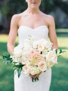 Classic dahlia, rose and ranunculus bouquet: http://www.stylemepretty.com/2015/11/03/elegant-blush-pink-duke-gardens-wedding/ | Photography: Callie Davis - http://nancyrayphotography.com/