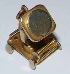 Ever seen a gold charm like this? Its a WW2 searchlight, and very rare. Buy it if you are a collector.www.vintagetom.co.uk
