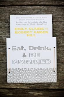 Playful wedding invitation with pull-out card