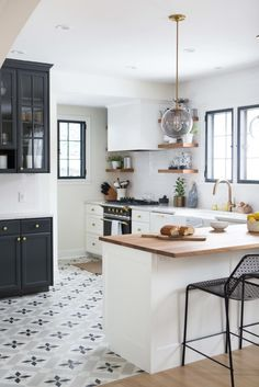 This kitchen has all the right essentials and exudes warmth and light! You can never go wrong with a traditional black and white color scheme.
