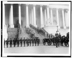 [Coffin of the Unknown Soldier being brought down steps of the U.S. Capitol, where horse-drawn wagon awaits; military personnal stand at attention] Library of Congress