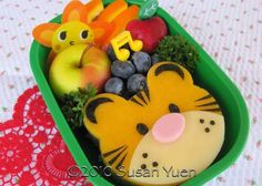 use bear cutter and make the tiger with cheese and food markers?