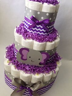 This purple elephant diaper cake will be the perfect addition to your baby shower. It can be used as a centerpiece or around the space to