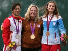 Kim Rhode - wins Gold in Women's Skeet Shooting - the first US Olympian to medal in 5 straight Olympics and set an Olympic record hitting 99 of her 100 targets.   NBC Olympics --- Then she shared the podium with her competitors. Love it!