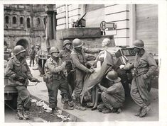 A Group Of American Soldiers Ridiculizing Nazism By Dressing A Mannequin In A Nazi Flag #souvenir Germany #WorldWar2