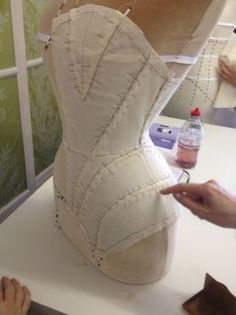 Oxford School of Corsetry - At first glance, I thought this was a hood... would love a pieced, shaped hood like this