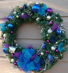 blue and silver ornaments on an artificial wreath | Turquoise Blue and Purple Christmas Wreath by Nannysfrontroom