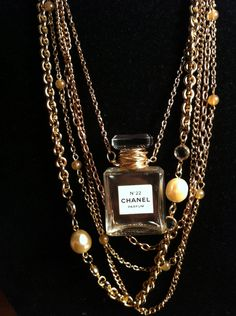 Vintage Chanel perfume bottle fashion necklace by SavannaCrow. An empty Chanel No. 22 miniature perfume bottle put to very good (and beautiful) use.