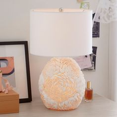 Adorned with a cluster of shells that are handplaced in a floral-like pattern, this romantic lamp glows softly and has three different settings to choose from - light up the base, shade or both for the perfect topper to your table, vanity or desk. Unique Lamps, Unique Lighting, Bright Homes, Concrete Lamp, Rustic Lamps, White Table Lamp, Home Decor Furniture, Pbteen, Accent Decor