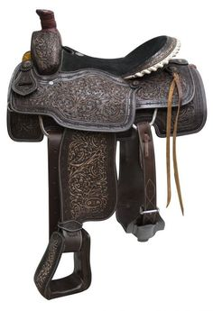 """16"""" Circle S Roper Saddle with antiqued tooling. This saddle features dark tooled leather with light brushed antique finish. Saddle is accented with brushed copper starburst conchos and a leather wrap"""