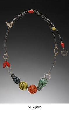 Liz Schock......Connie Fox: Red unifies the necklace.