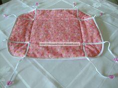 PASSO A PASSO: 1- Riscamos os tecidos… 2- ficando assim: o2 tecidos estampados e a manta acrílica… 3- Colocamos a manta no meio e alinhavamos… 4- Passamos quatro costuras… 5…