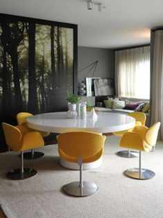 use of grays, yellows, and purples to create a dark yet contradicting-ly bright, mellow, and cozy room