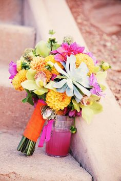 The bridal bouquet was a source of bright color with stand-out hues of gold, green and fuchsia.