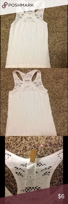 Cute stretch white top Excellent condition no stains one size but fits a small perfect Tops Tank Tops