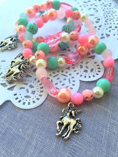 Unicorn kids birthday party favor, unicorn jewelry, kids jewelry, SET of TEN. ************************** Party planning is already so stressful. Leave the favors up to us! This listing is for TEN bracelets. DETAILS and MEASUREMENTS: Beads vary in sizes from 6mm-10mm. The length of a
