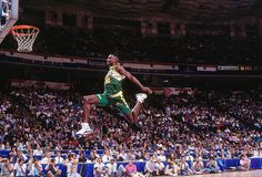 Seattle forward Shawn Kemp attempts a dunk during the 1991 Slam Dunk Contest in Charlotte, NC. Kemp would finish second to Celtics guard Dee Brown. (Nathaniel S. Butler/Getty Images) SI VAULT: Just an...