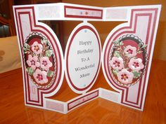 Tattered Lace shutter card folds into a DL envelope even with the handmade flowers on it.