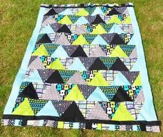 Cool and Quick Triangle Quilt Pattern.. This would be a great starter quilt or baby quilt