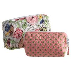 "Two quilted cosmetics bags in polka dots and floral prints.     Product: Small and large cosmetic bag Construction Material: FabricColor: MultiDimensions: 7"" H x 9.5"" W x 3.5"" D (large)"