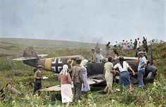 Soviet farmers inspect downed German plane.