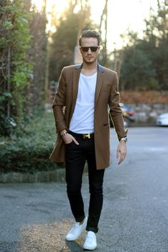 Shop this look on Lookastic: http://lookastic.com/men/looks/overcoat-jeans-low-top-sneakers-crew-neck-t-shirt-watch/9581 — Camel Overcoat — Black Jeans — White Low Top Sneakers — White Crew-neck T-shirt — Silver Watch