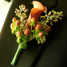 Brides: Calla Lily and Berry Boutonniere. The groom sported a boutonniere that complemented the bride%u2019s bouquet%u2014a single mango calla lily paired with hypericum berries by Marla Courtney Wood.